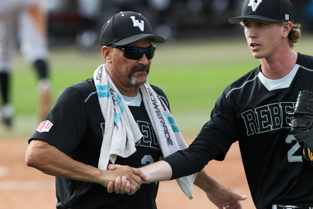 UNLV head coach Tim Chambers congratulates pitcher Blaze Bohall after an inning during their 7-1 defeat of Grand Canyon University Tuesday, March 17, 2015 at Earl E. Wilson Stadium. (Sam Morris/La ...
