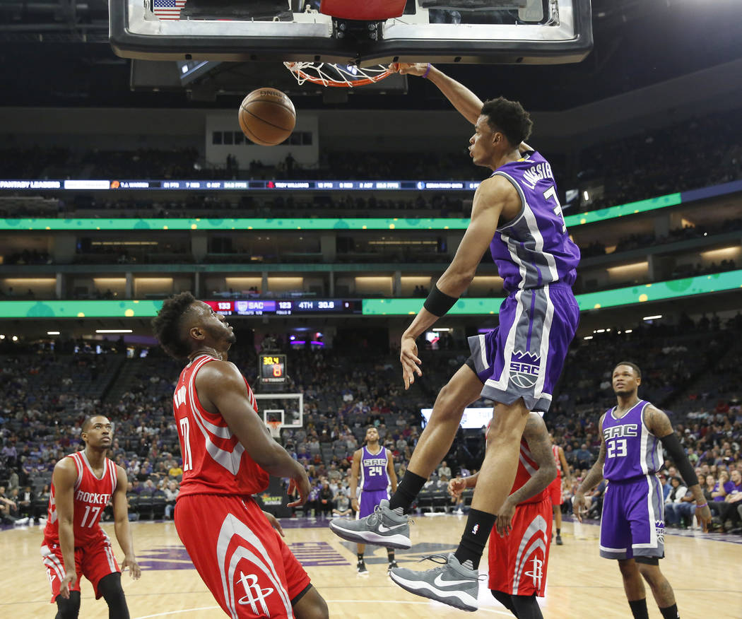 Sacramento Kings forward Skal Labissiere, right, stuffs over Houston Rockets forward Chinanu Onuaku during the second half of an NBA basketball game, Sunday, April 9, 2017, in Sacramento, Calif. T ...
