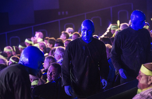 Alain Rochefort, middle, captain of the Blue Man Group Las Vegas, interacts with the crowd during the show on Tuesday, Jan. 31, 2017, at the Luxor hotel-casino, in Las Vegas. (Benjamin Hager/Las V ...