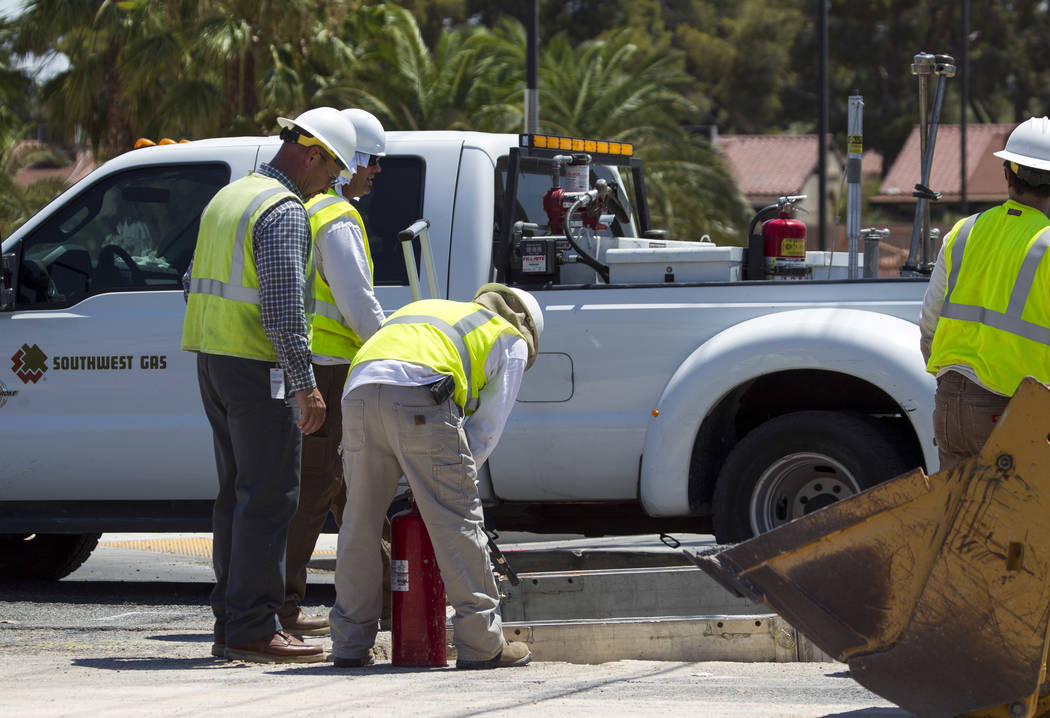 Repair crews for Southwest Gas address a line break on South Eastern Avenue between East Rochelle Avenue and East Flamingo Road on Thursday, July 6, 2017. (Richard Brian/Las Vegas Review-Journal)  ...