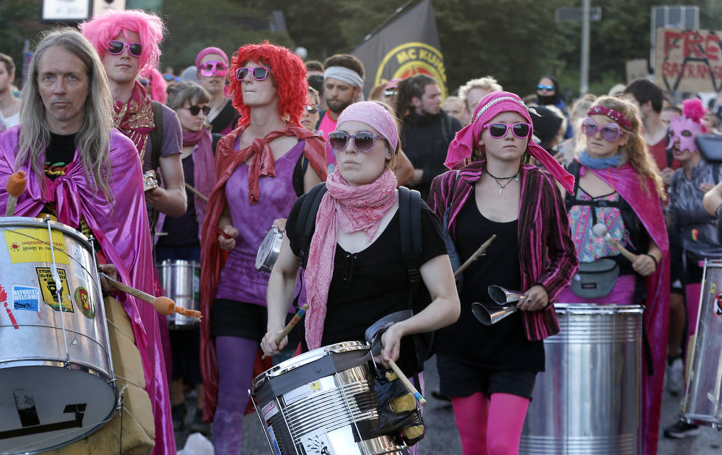 Protesters drum during a protest against the G-20 summit in Hamburg, Germany, Thursday, July 6, 2017. (Michael Probst/AP)