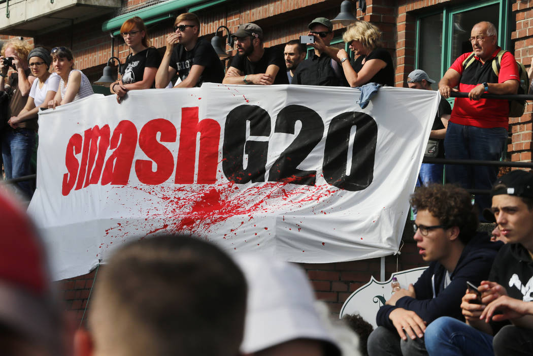 "Demonstrators wait for the beginning of a protest titled ""Welcome to Hell"" against the G-20 summit in Hamburg, Germany, Thursday, July 6, 2017. (Michael Probst/AP)"