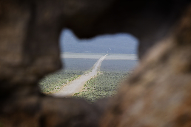 A barren road shot through a rock outcropping is seen Wednesday, May 20, 2015, in Garden Valley, over a three-hour drive north of Las Vegas. Over 800,000 acres in central Nevada is proposed as the ...
