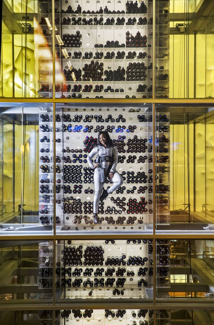 Eboni Lomax has been a wine angel at Aureole for the past 10 years, scaling its four-story wine tower containing close to 3000 bottles. Lomax appeared on an episode of the Oprah Winfrey Show in 20 ...