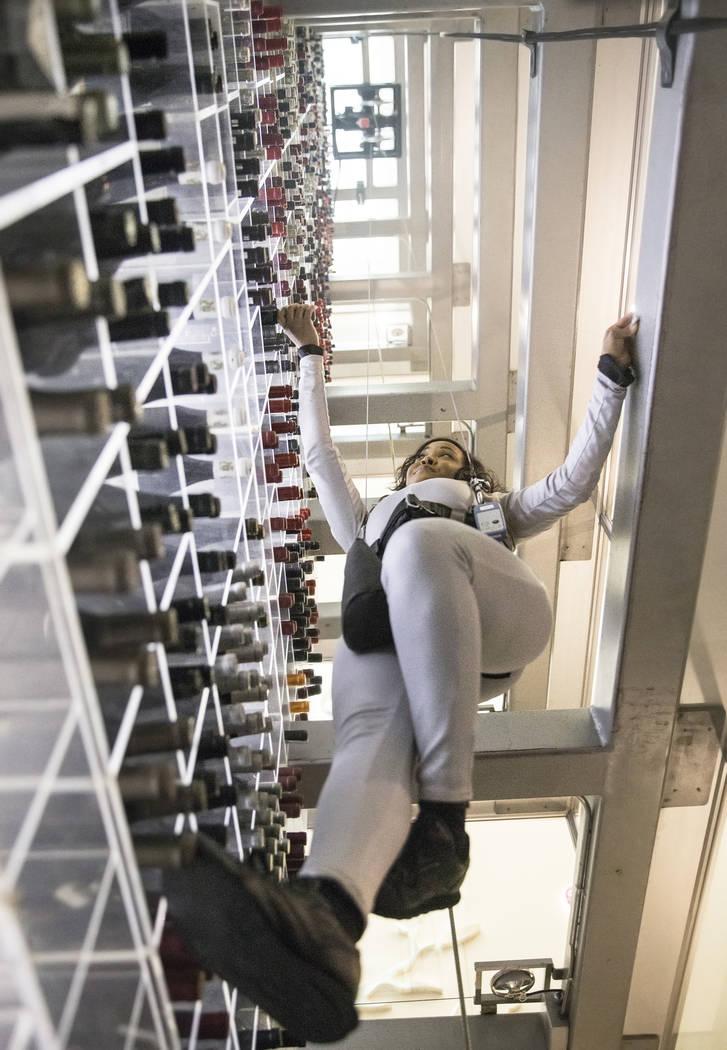 Wine angel Eboni Lomax fulfills guest orders at Aureole on Thursday, July 6, 2017, at Mandalay Bay hotel-casino, in Las Vegas. Benjamin Hager Las Vegas Review-Journal @benjaminhphoto