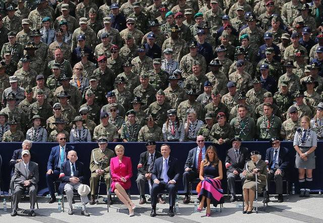 U.S. First Lady Melania Trump, Polish President Andrzej Duda and Polish First Lady Agata Kornhauser-Duda listen to U.S. President Donald Trump's public speech at Krasinski Square, in Warsaw, Polan ...