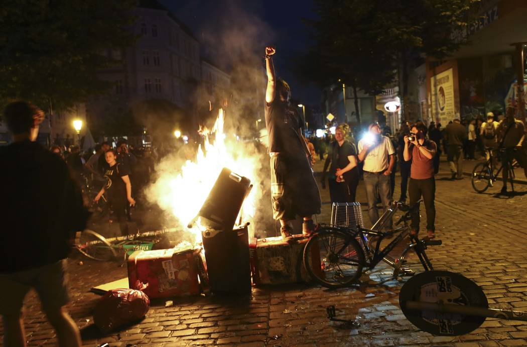 Anti-G20 protesters light garbage in the middle of a road in the Schanze district following clashes with German riot police in Hamburg, Germany, July 6, 2017. REUTERS/Kai Pfaffenbach