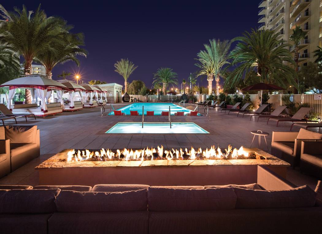 SPARK at One Las Vegas features a fire pit, barbecue grills and summer kitchens, perfect for summer gatherings with friends, family and neighbors. SPARK is one of many other resident amenities exc ...