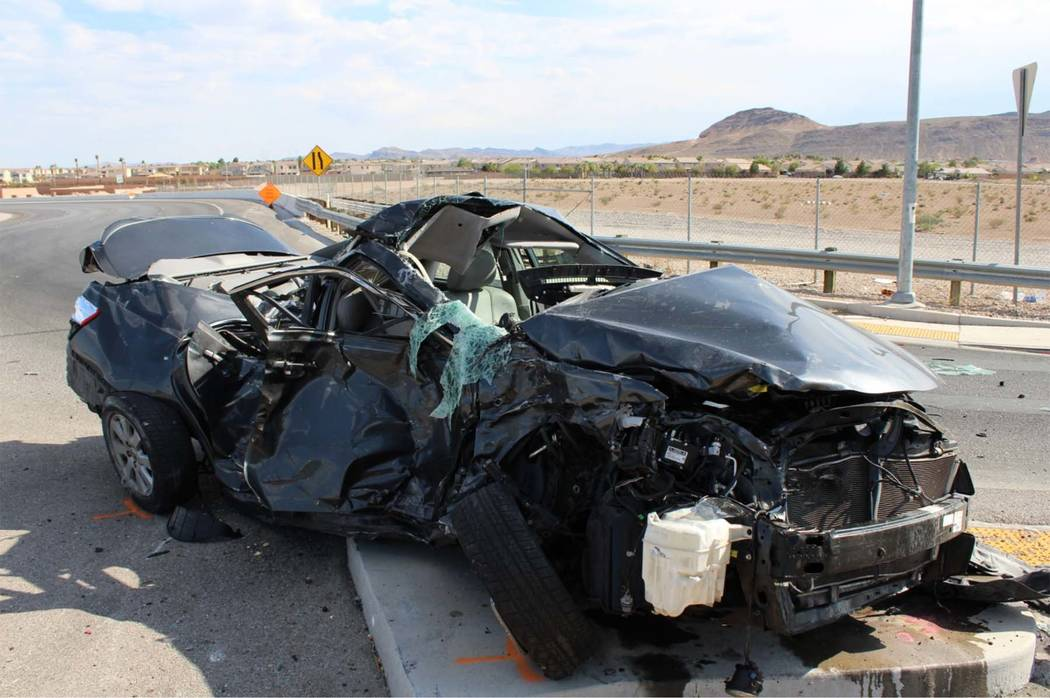 A 22-year-old woman driving a Toyota Camry died after a crash at 215 Beltway and Sunset Road offramp in southwest Las Vegas, Wednesday, July 5, 2017. (Nevada Highway Patrol)