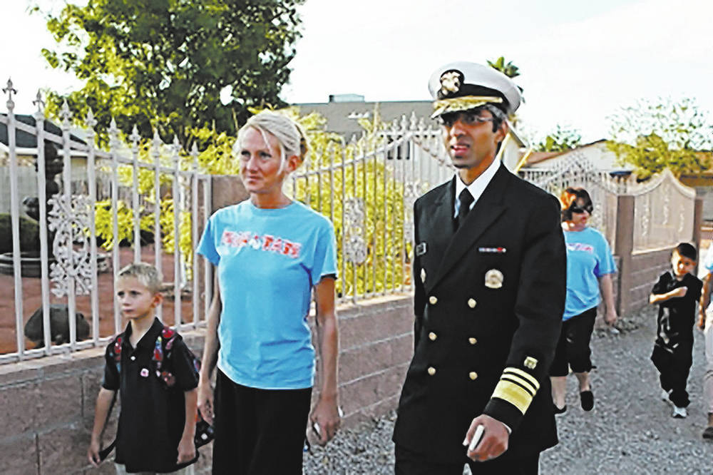 Tate Elementary School Principal Sarah Popek, second from left, walks with her son, left, and former U.S. Surgeon General Vivek Murthy during a group walk at the school in September 2015. (File)