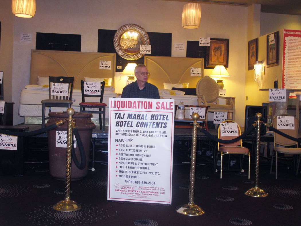 An employee of a liquidation company waits for customers at the former Trump Taj Mahal casino in Atlantic City, N.J., on Thursday July 6, 2017, moments before a sale of the casino hotel's contents ...