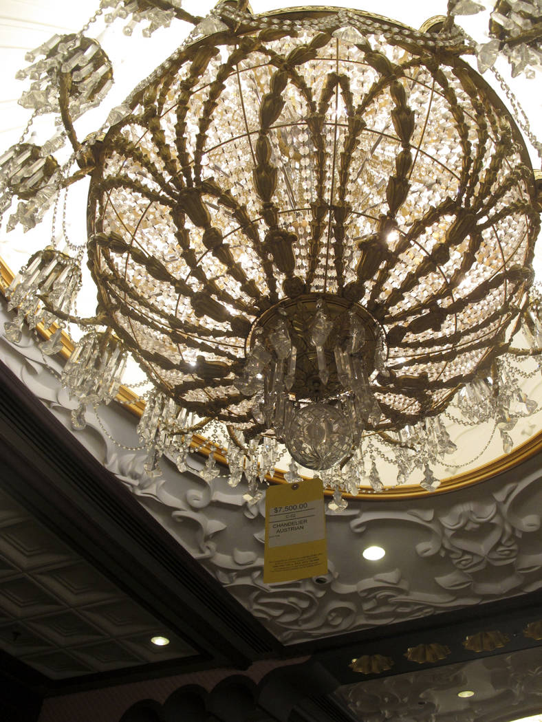A crystal chandelier at the former Trump Taj Mahal casino in Atlantic City N.J. is tagged with a $7,500 price tag on Thursday July 6, 2017, during a sale of the casino hotel's contents. Included i ...