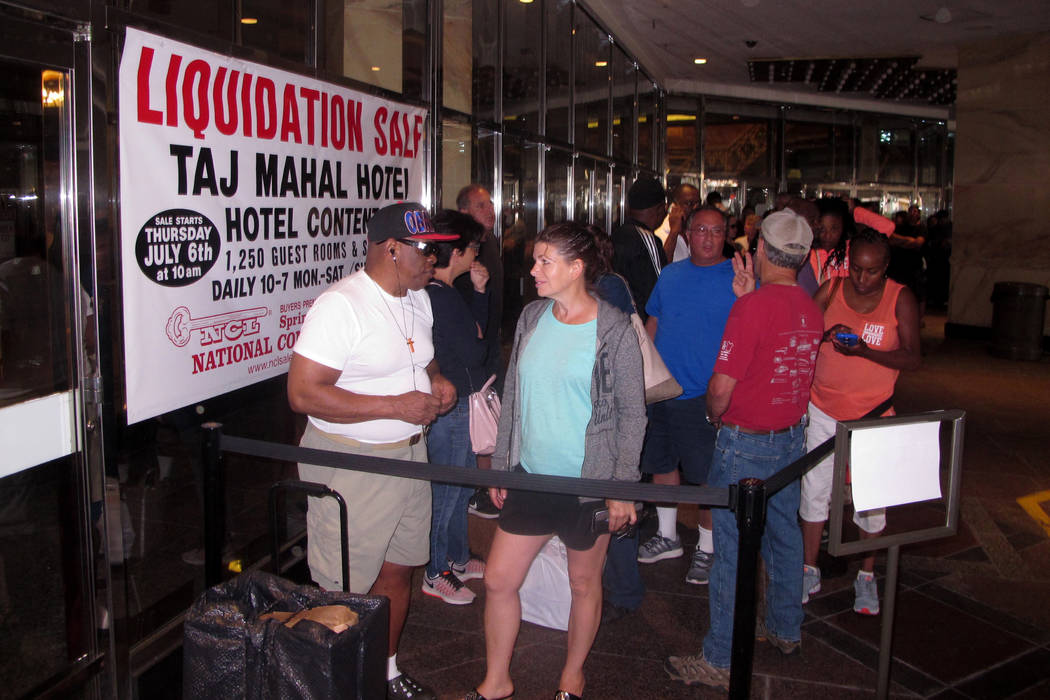 Gerald Winchester, left, chats with Marie Marine, right, as they wait to enter the former Trump Taj Mahal casino in Atlantic City, N.J., on Thursday July 6, 2017, for a sale of the casino hotel's  ...