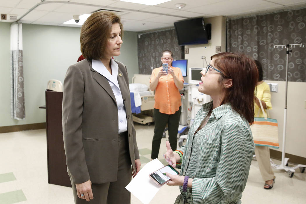 Karen Stiles, center, takes a photo as U.S. Sen. Catherine Cortez Masto, D-Nev., left, talks to her daughter Jenny after Masto held a press conference at University Medical Center on Friday, July  ...