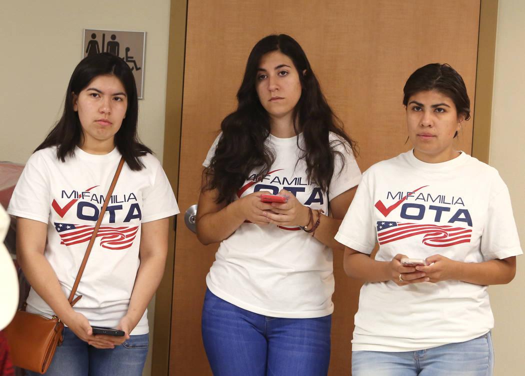 Elizabeth Garcia, left, Joseline Alvarez, and Arlene Alvarez, listen to U.S. Sen. Catherine Cortez Masto, D-Nev., during a press conference held at University Medical Center by Nevadans Together f ...