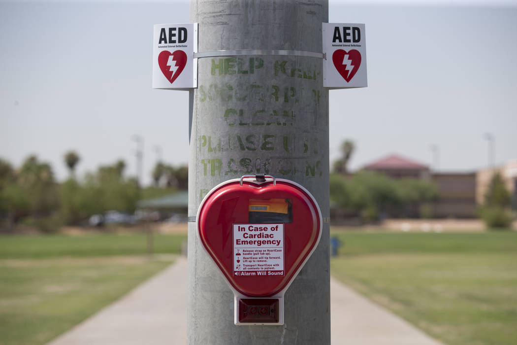 An automated external defibrillator (AED) hangs on a lamp post at the Bettye Wilson Soccer Complex in Las Vegas, Thursday, July 6, 2017.  Richard Brian Las Vegas Review-Journal @vegasphotograph