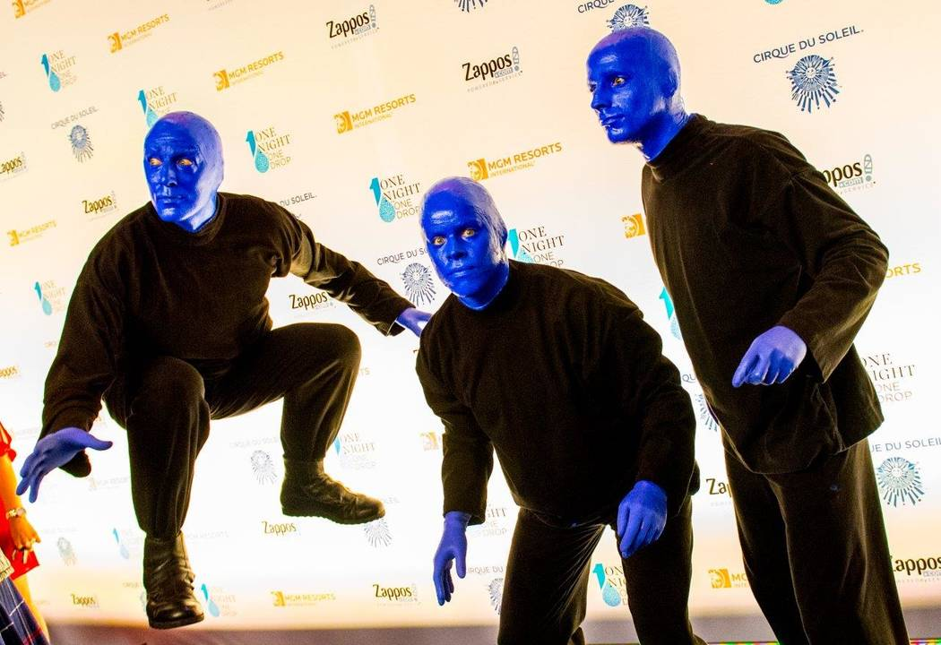 """Blue Man Group arrives on the blue carpet for the fifth-annual """"One Night for One Drop"""" by Cirque du Soleil at """"Zumanity"""" Theater at New York-New York on Friday, March 3, 2017, in Las Vegas. (Tom  ..."""