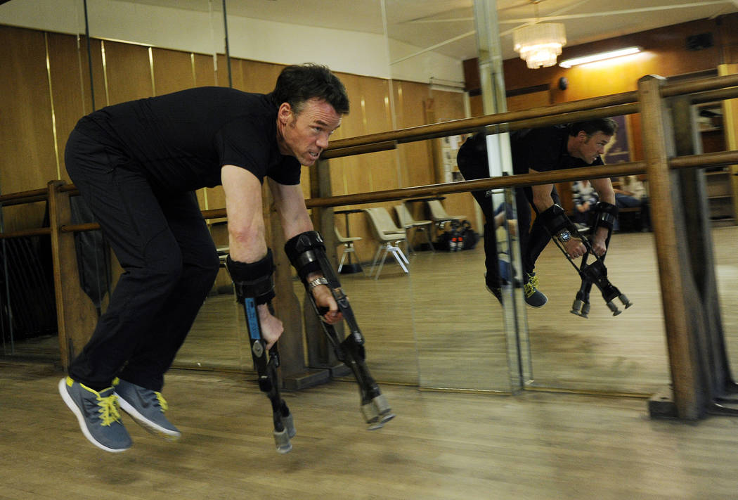 "In this Tuesday, June 24, 2014 photo, Terry Notary, a stuntman on the film ""Dawn of the Planet of the Apes,"" demonstrates how he achieved ape-like movements with arm extenders for his motion captu ..."