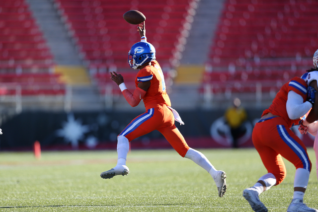 Bishop Gorman's Dorian Thompson-Robinson (14) throws a pass against Liberty in the Class 4A state football championship game at Sam Boyd Stadium on Saturday, Dec. 3, 2016, in Las Vegas. Bishop Gor ...