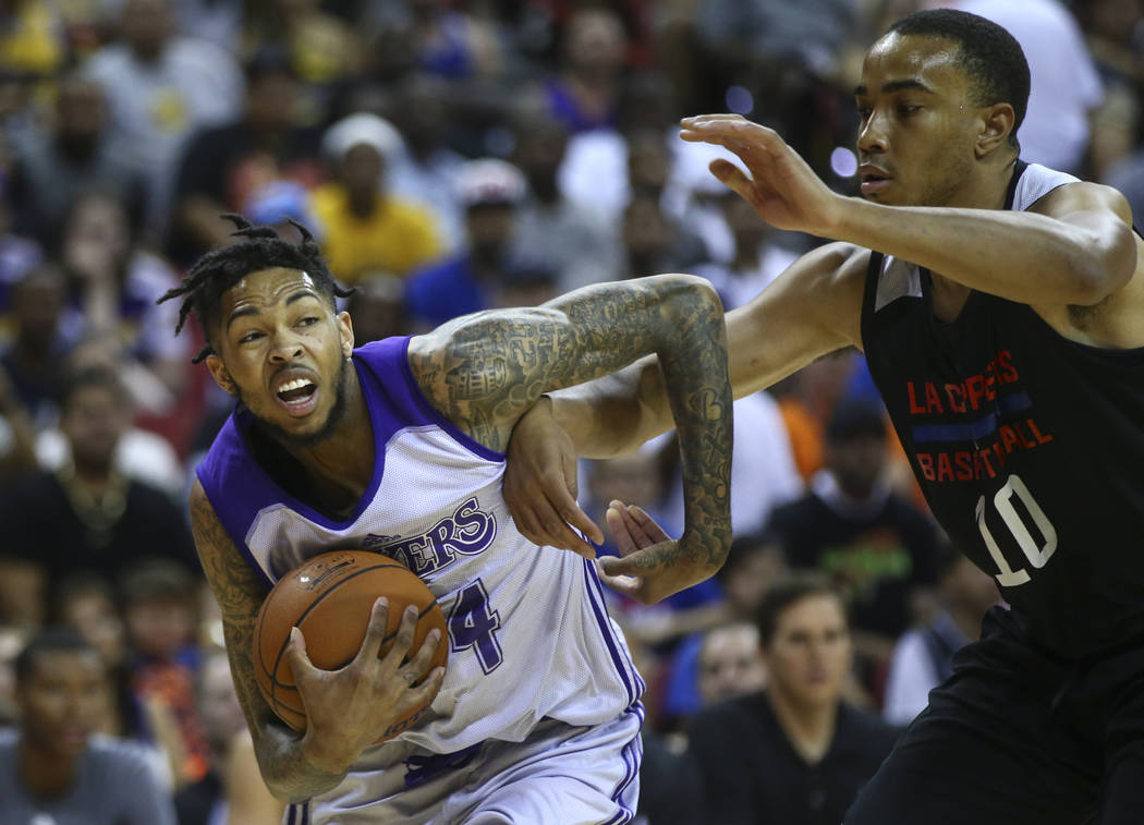 Los Angeles LakersՠBrandon Ingram drives against Los Angeles ClippersՠBrice Johnson during a basketball game at the NBA Summer League at the Thomas & Mack Center in Las Vegas on Fr ...