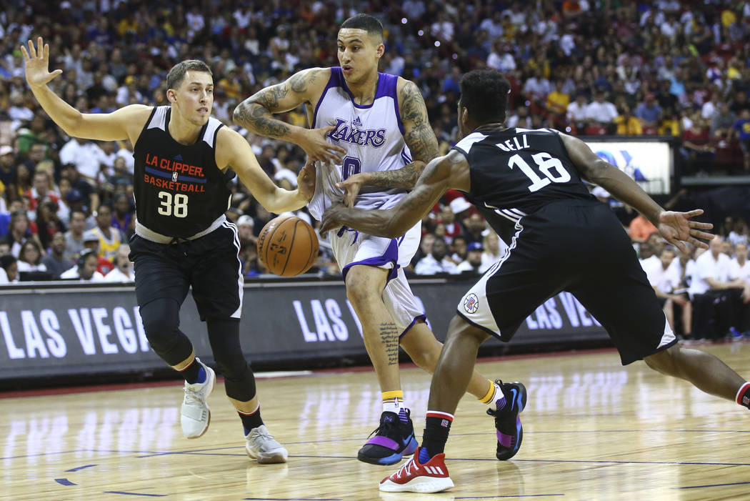 Los Angeles LakersՠKyle Kuzma (0) loses control of the ball as Los Angeles ClippersՠKyle Wiltjer (38) and James Bell (18) defend during a basketball game at the NBA Summer League at th ...