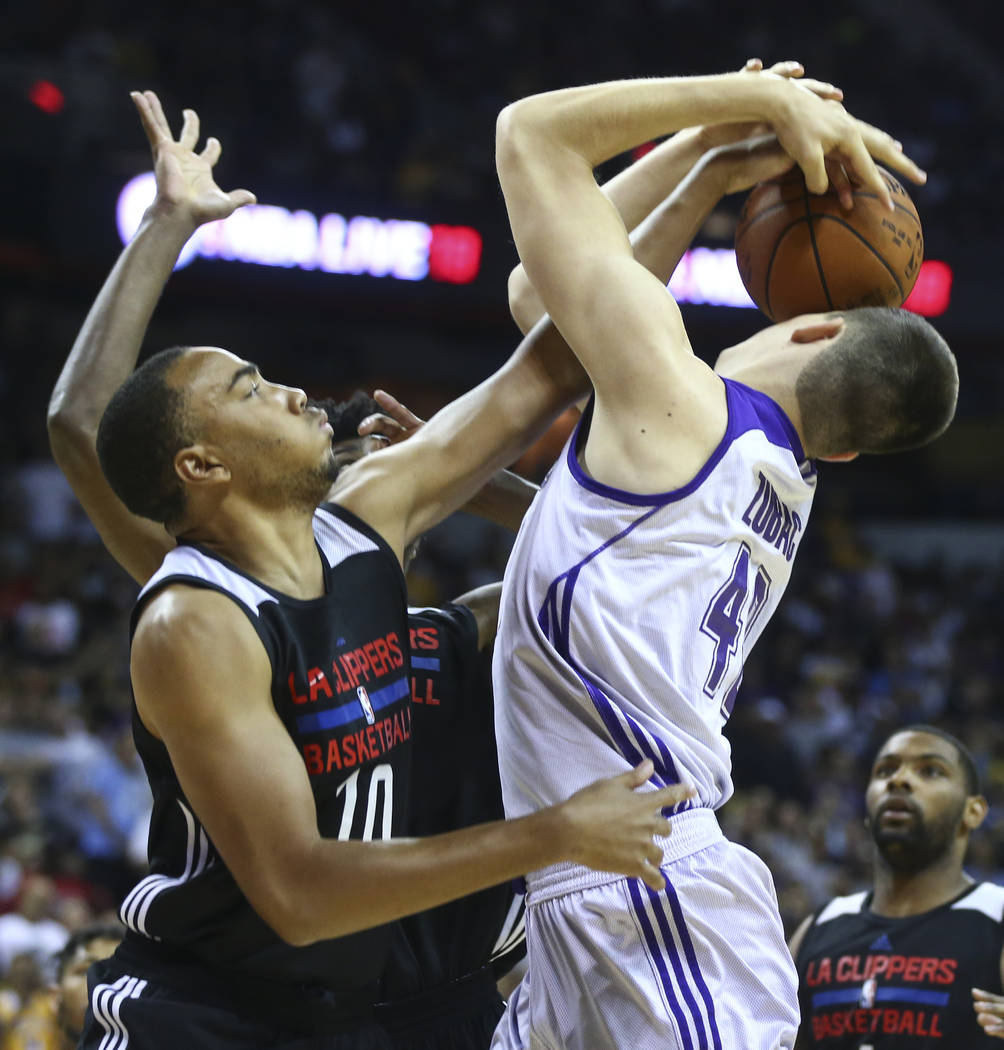 Los Angeles ClippersՠBrice Johnson blocks a shot from Los Angeles LakersՠIvica Zubac during a basketball game at the NBA Summer League at the Thomas & Mack Center in Las Vegas on F ...