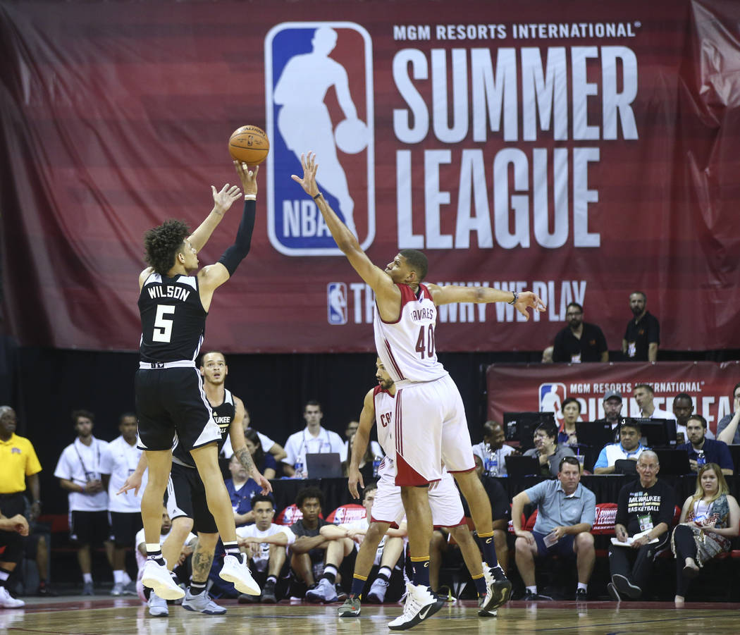 Milwaukee Bucks' D.J. Wilson (5) shoots over Cleveland Cavaliers' Edy Tavares (40) during a basketball game at the NBA Summer League at the Thomas & Mack Center in Las Vegas on Friday, July 7, ...