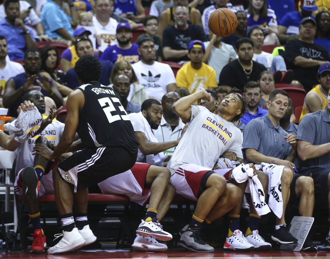 Players on the Cleveland Cavaliers' bench dodge a loose ball during a basketball game against the Milwaukee Bucks at the NBA Summer League at the Thomas & Mack Center in Las Vegas on Friday, J ...