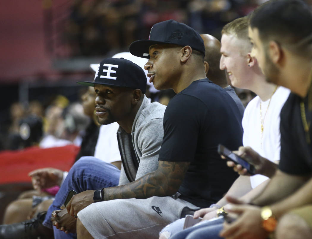 Floyd Mayweather, left, and Isaiah Thomas of the Boston Celtics during a basketball game at the NBA Summer League at the Thomas & Mack Center in Las Vegas on Friday, July 7, 2017. Chase Steven ...