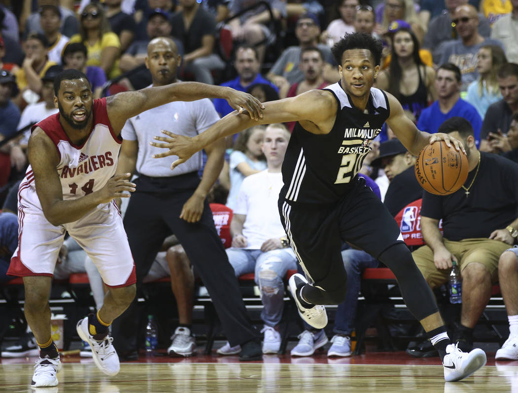 Milwaukee Bucks' Rashad Vaughn (20) drives against Cleveland Cavaliers' Sam Cassell, Jr. (14) during a basketball game at the NBA Summer League at the Thomas & Mack Center in Las Vegas on Frid ...