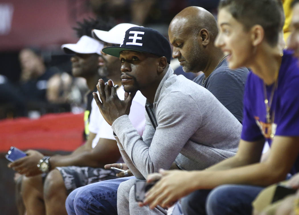 Floyd Mayweather takes in the action as the Cleveland Cavaliers play the Milwaukee Bucks during a basketball game at the NBA Summer League at the Thomas & Mack Center in Las Vegas on Friday, J ...