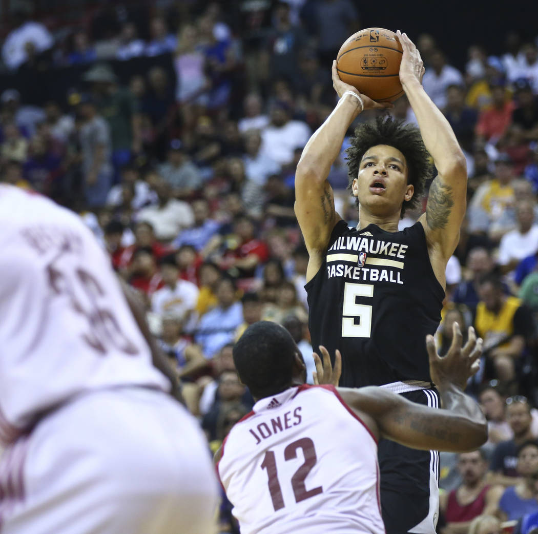 Milwaukee Bucks' D.J. Wilson (5) shoots over Cleveland Cavaliers' Roosevelt Jones (12) during a basketball game at the NBA Summer League at the Thomas & Mack Center in Las Vegas on Friday, Jul ...