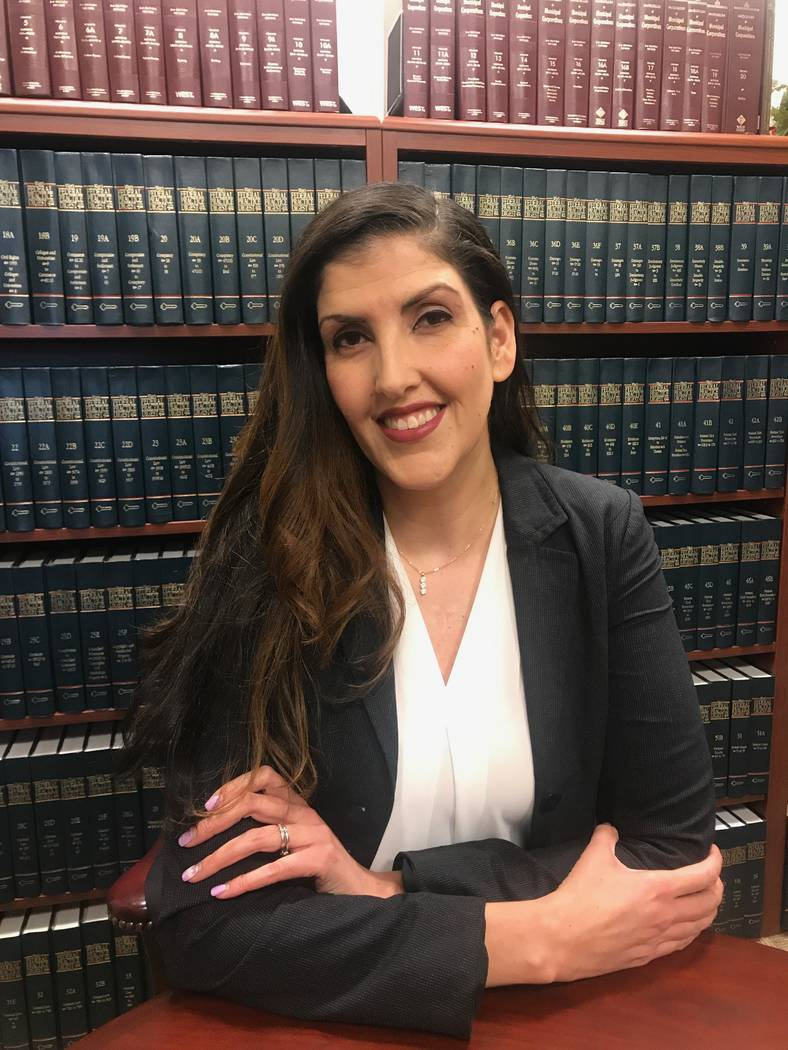 Senior Deputy City Attorney Claudia Aguayo in library on June 6 at the City of North Las Vegas' city attorney's office. (Kailyn Brown/View) @KailynHype