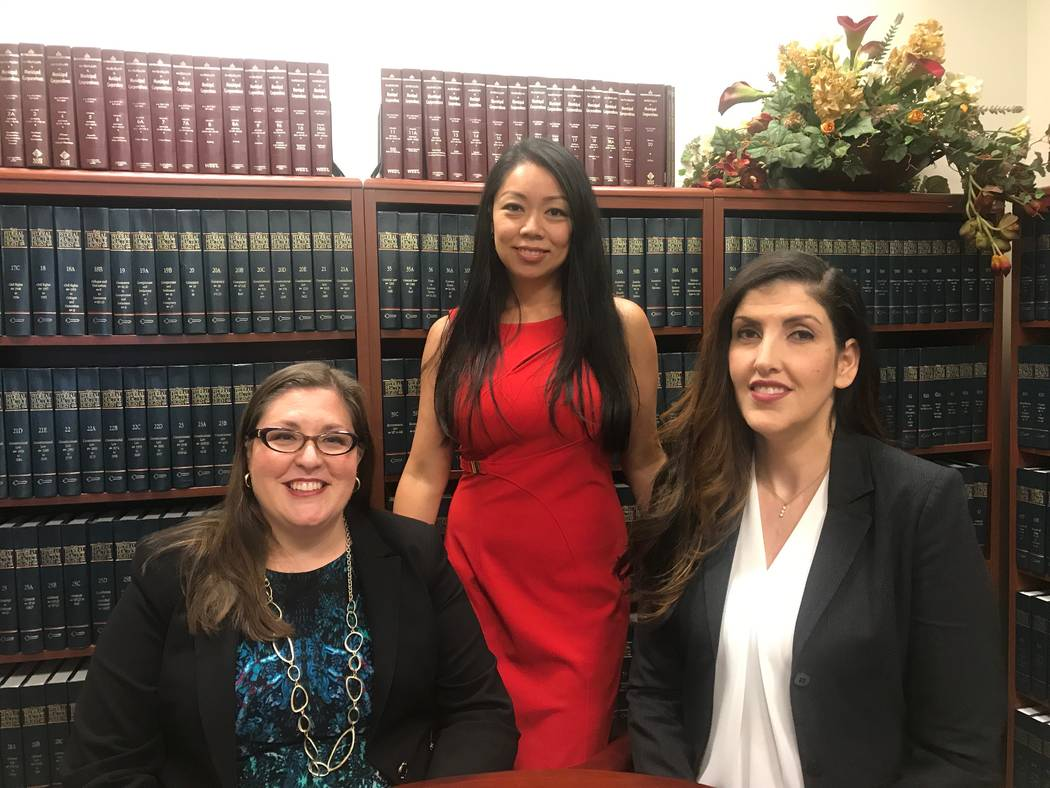 From left, Senior Deputy City Attorney Claudia Aguayo, City Attorney Micaela Moore and Chief Deputy City Attorney Bethany Rudd Sanchez,  in library on June 6 at the City of North Las Vegas' city a ...