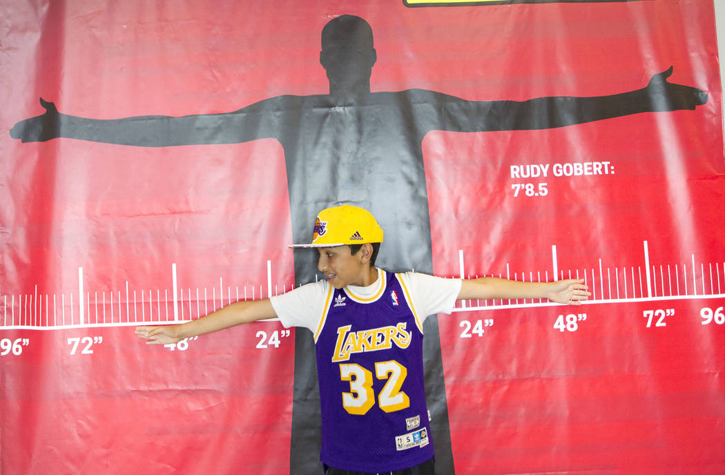 Josh Melamed, 13, of Los Angeles compares his wingspan to Utah Jazz's Rudy Gobert during the NBA Summer League at the Thomas & Mack Center and Cox Pavilion, Monday, July 10, 2017. Richard Bria ...
