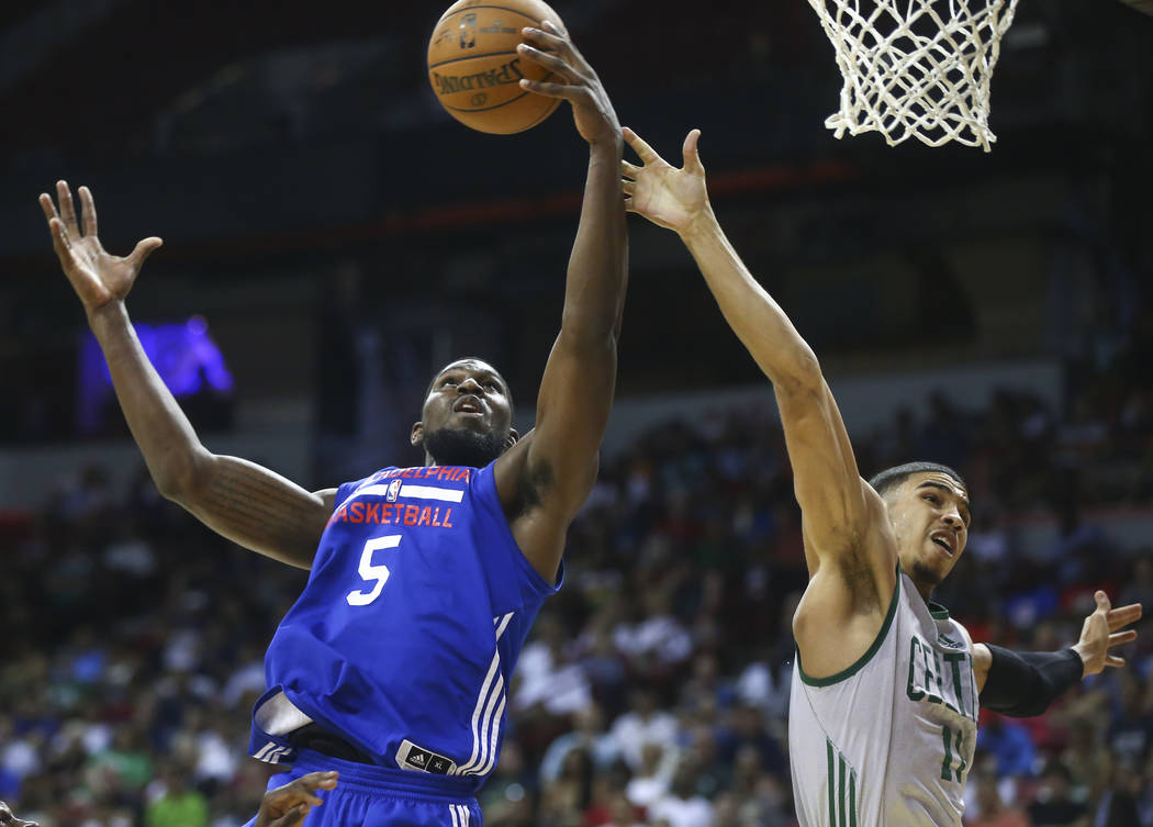 Philadelphia 76ers' Alex Poythress (5) grabs a rebound over Boston Celtics' Jayson Tatum (11) during a basketball game at the NBA Summer League at the Thomas & Mack Center in Las Vegas on Tues ...