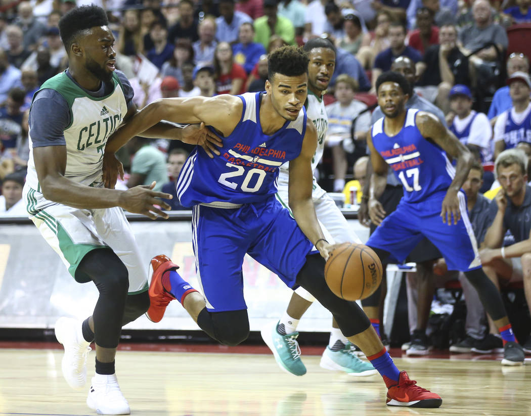 Philadelphia 76ers' Timothe Luwawu-Cabarrot (20) drives to the basket against Boston Celtics' Jaylen Brown during a basketball game at the NBA Summer League at the Thomas & Mack Center in Las  ...