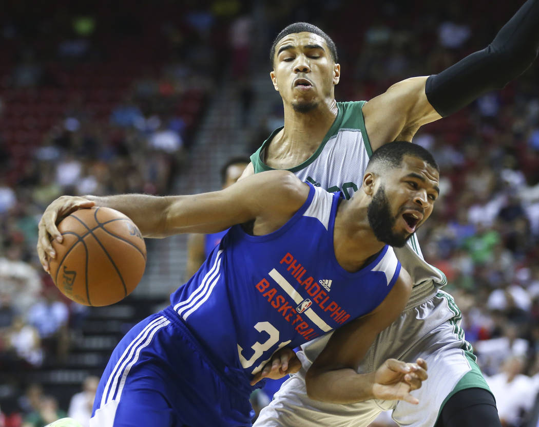 Philadelphia 76ers' Aaron Harrison (31) drives to the basket against Boston Celtics' Jayson Tatum (11) during a basketball game at the NBA Summer League at the Thomas & Mack Center in Las Vega ...
