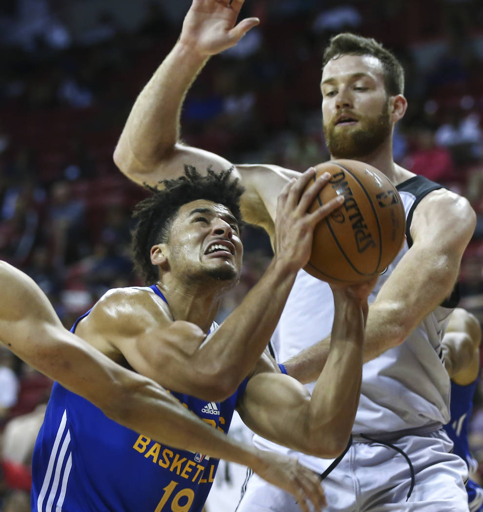 Golden State Warriors' Tai Webster (19) looks for an open shot as Minnesota Timberwolves' Matt Costello (25) defends during a basketball game at the NBA Summer League at the Thomas & Mack Cent ...