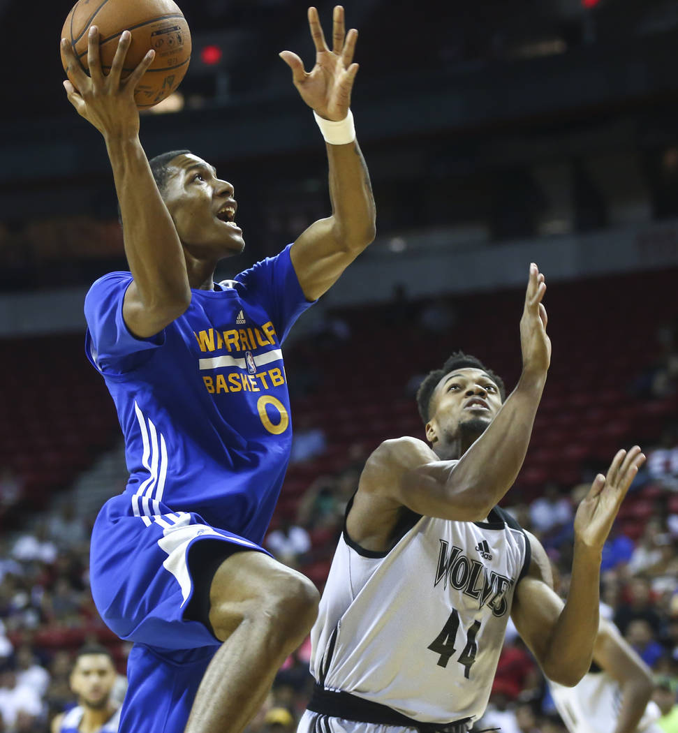Golden State Warriors' Patrick McCaw (0) goes to the basket over Minnesota Timberwolves' Charles Cooke (44) during a basketball game at the NBA Summer League at the Thomas & Mack Center in Las ...