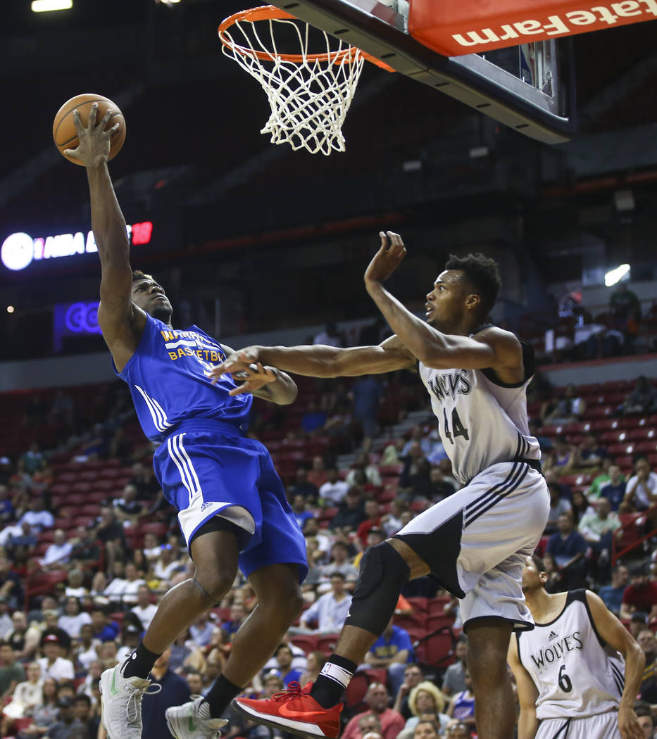 Golden State Warriors' Dylan Ennis (31) shoots against Minnesota Timberwolves' Charles Cooke (44) during a basketball game at the NBA Summer League at the Thomas & Mack Center in Las Vegas on  ...