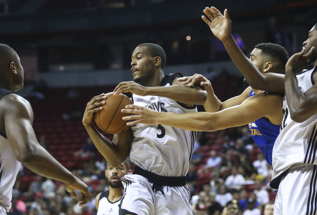 Minnesota Timberwolves' V.J. Beachem (3) holds onto a rebound against the Golden State Warriors during a basketball game at the NBA Summer League at the Thomas & Mack Center in Las Vegas on Tu ...