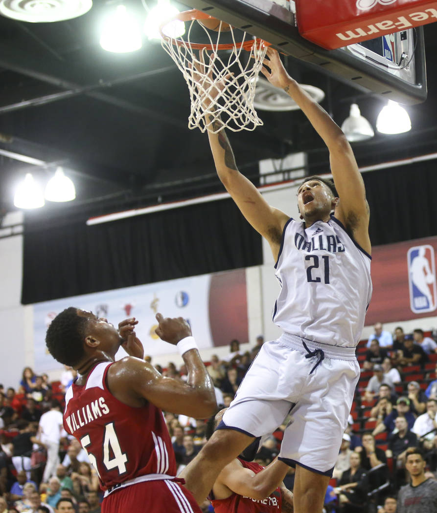 Dallas Mavericks' Brandon Ashley (21) shoots over Miami Heat's Matt Williams (54) during a basketball game at the NBA Summer League at the Thomas & Mack Center in Las Vegas on Tuesday, July 11 ...