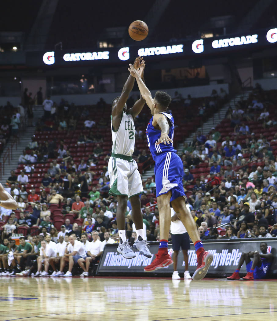 Boston Celtics' Jabari Bird (26) shoots over Philadelphia 76ers' Jonah Bolden (43) during a basketball game at the NBA Summer League at the Thomas & Mack Center in Las Vegas on Tuesday, July 1 ...