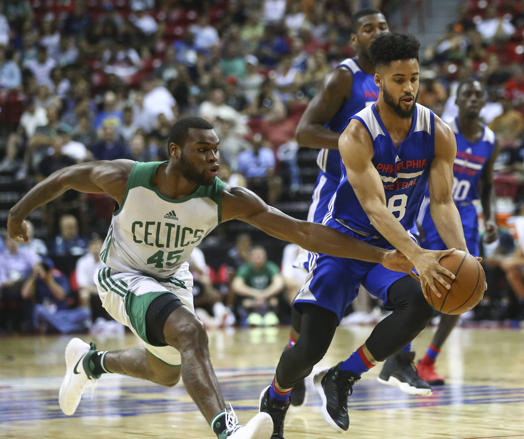 Boston Celtics' Kadeem Allen (45) tries to steal the ball from Philadelphia 76ers' Melo Trimble (18) during a basketball game at the NBA Summer League at the Thomas & Mack Center in Las Vegas  ...