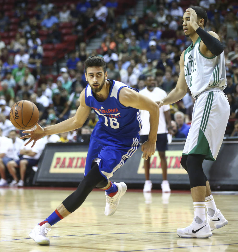 Philadelphia 76ers' Furkan Korkmaz (16) drives past Boston Celtics' Jayson Tatum (11) during a basketball game at the NBA Summer League at the Thomas & Mack Center in Las Vegas on Tuesday, Jul ...