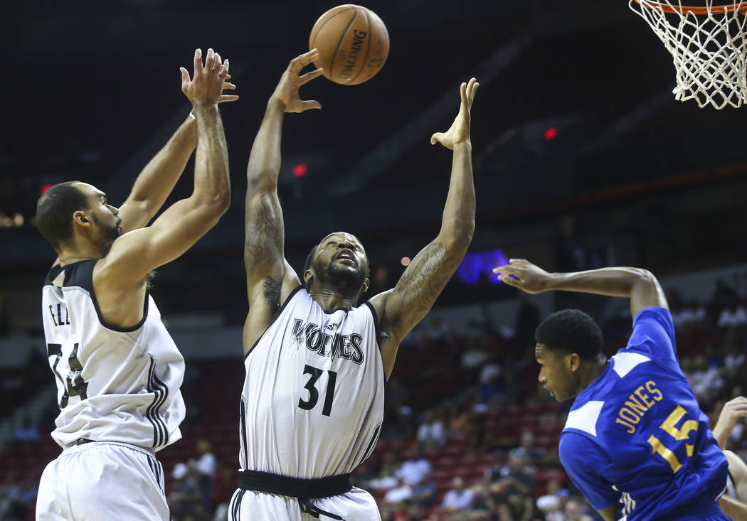Minnesota Timberwolves' Levi Randolph (31) and Perry Ellis (34)  reach out for a rebound during a basketball game against the Golden State Warriors at the NBA Summer League at the Thomas & Mac ...