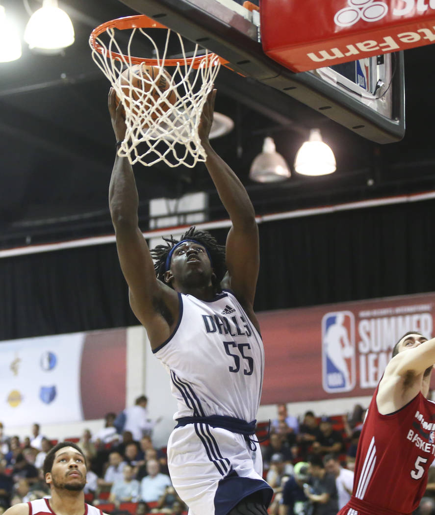 Dallas Mavericks' Johnathan Motley (55) shoots against the Miami Heat during a basketball game at the NBA Summer League at the Thomas & Mack Center in Las Vegas on Tuesday, July 11, 2017. Chas ...