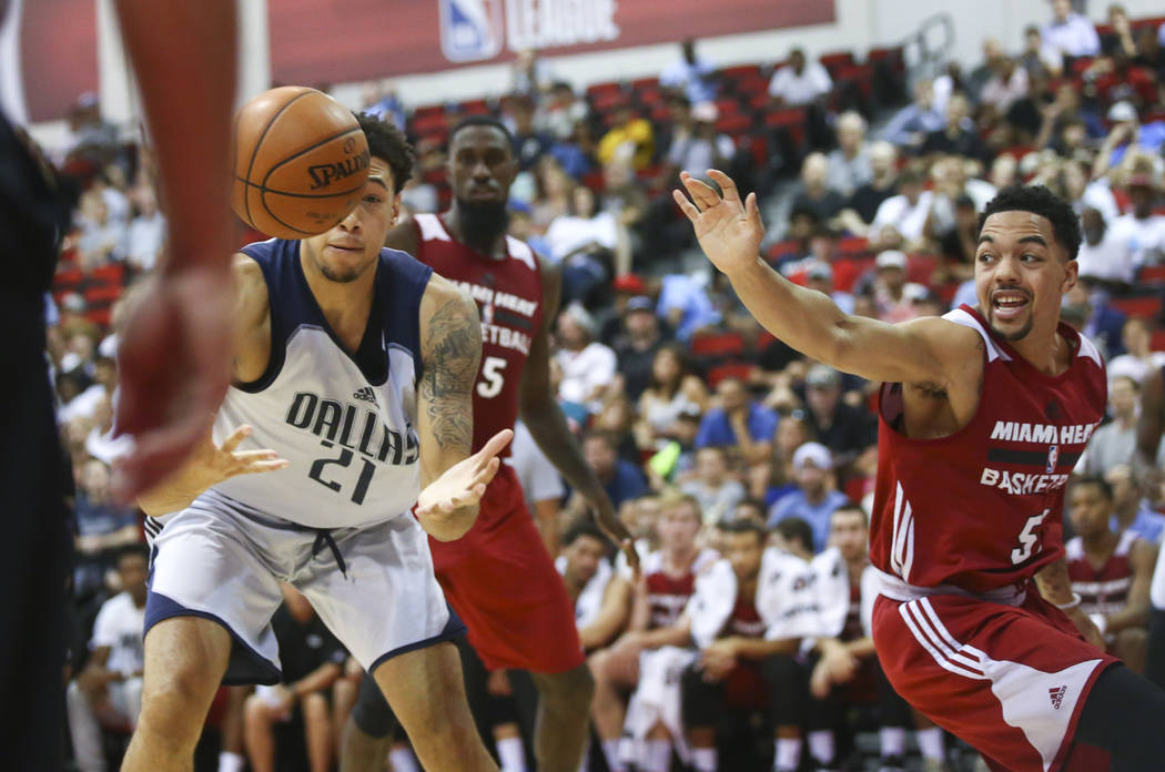 Dallas Mavericks' Brandon Ashley (21) reaches out for the ball as Miami Heat's Justin Robinson (51) defends during a basketball game at the NBA Summer League at the Thomas & Mack Center in Las ...