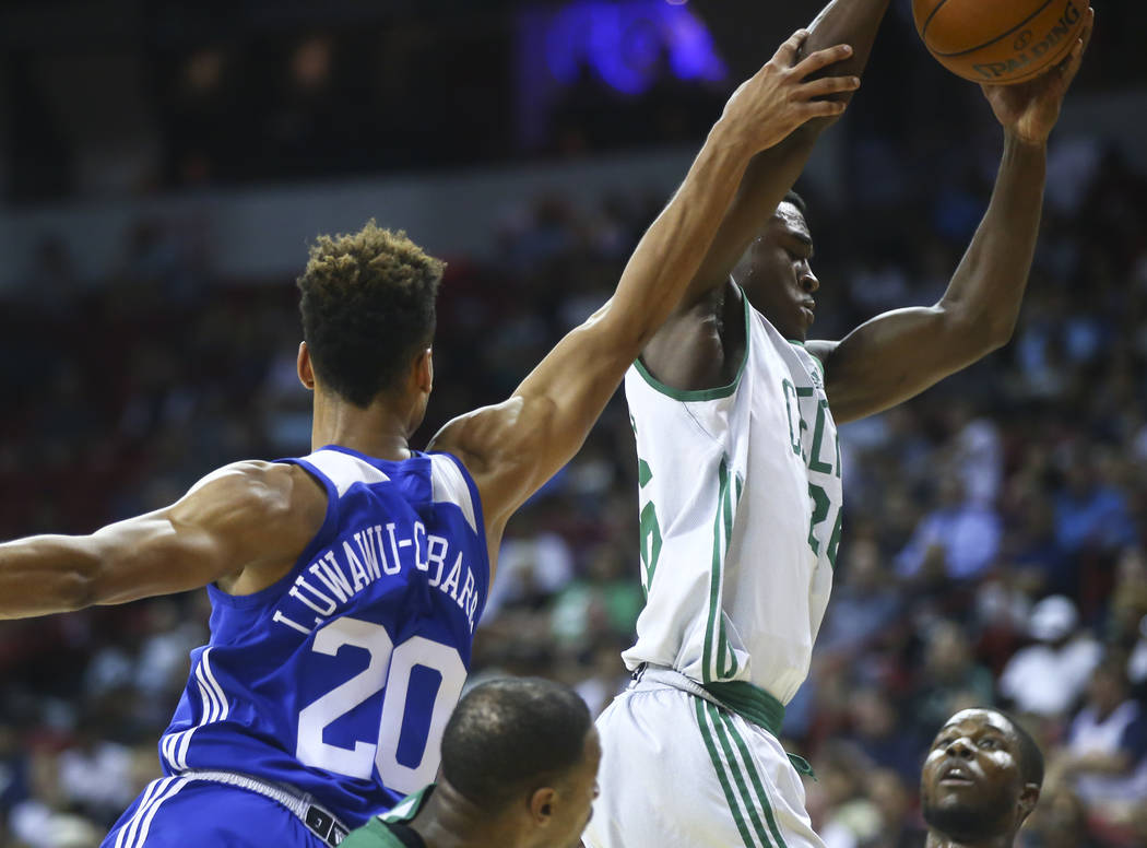 Boston Celtics' Jabari Bird (26) grabs a rebound over Philadelphia 76ers' Timothe Luwawu-Cabarrot (20) during a basketball game at the NBA Summer League at the Thomas & Mack Center in Las Vega ...